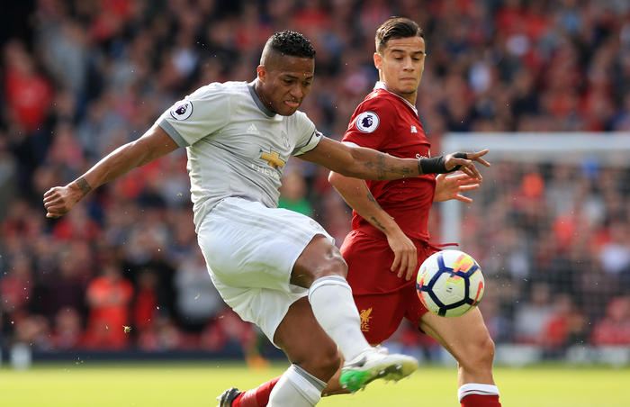 Manchester United's Antonio Valencia and Liverpool's Philippe Coutinho battle for the ball during the Premier League match at Anfield, Liverpool in 2017.