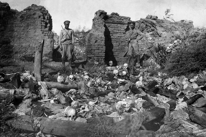 A picture released by the Armenian Genocide Museum-Institute dated 1915 purportedly shows soldiers standing over skulls of victims from the Armenian village of Sheyxalan in the Mush valley, on the Caucasus front during the First World War.