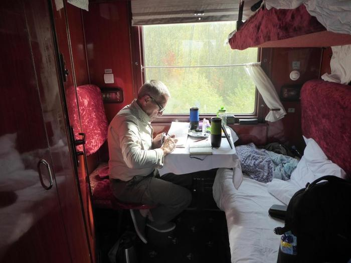 Phil Whiting sketching onboard the Trans Siberian train