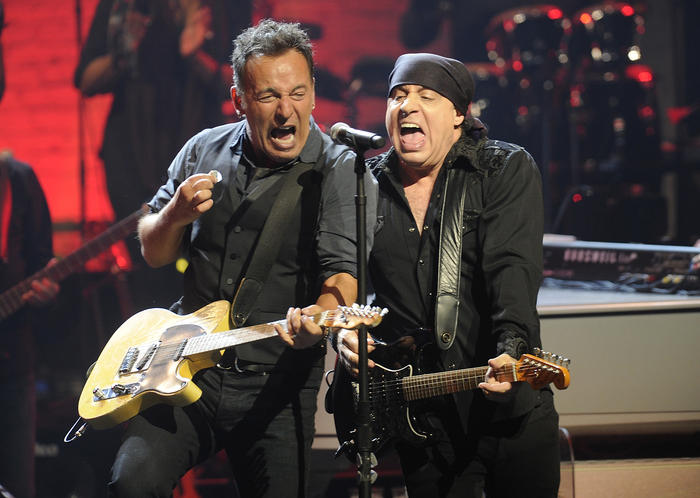 Bruce Springsteen, left, and Steven Van Zandt of the E Street Band perform at the Apollo Theater on Friday, March 9, 2012 in New York. The concert was hosted by SiriusXM in celebration of 10 years of satellite radio. (AP Photo/Evan Agostini)