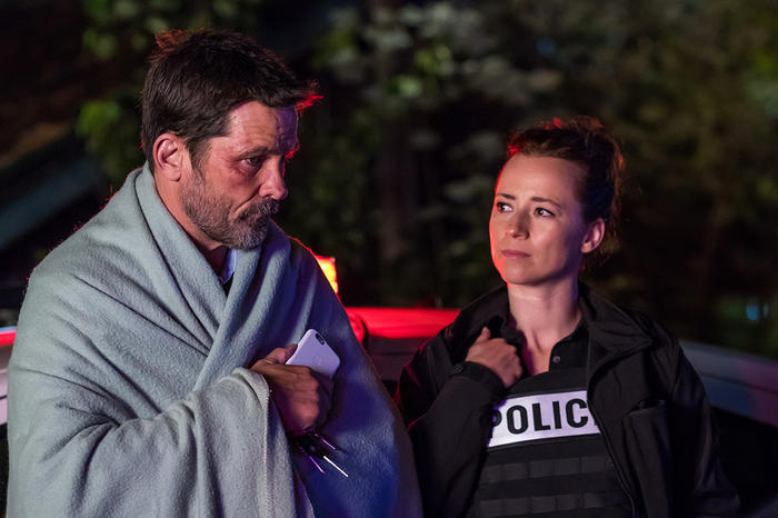 Cardinal (Billy Campbell) and Delorme (Karine Vanasse) in Cardinal
