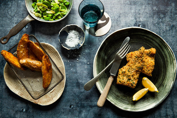 Baked fish and chips with broad beans