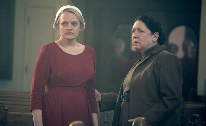THE HANDMAID'S TALE  Offred (Elisabeth Moss) and Aunt Lydia (Ann Dowd), shown. (Photo by: George Kraychyk/Hulu)