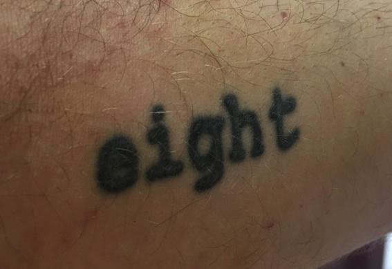 Author's tattoo of the word eight