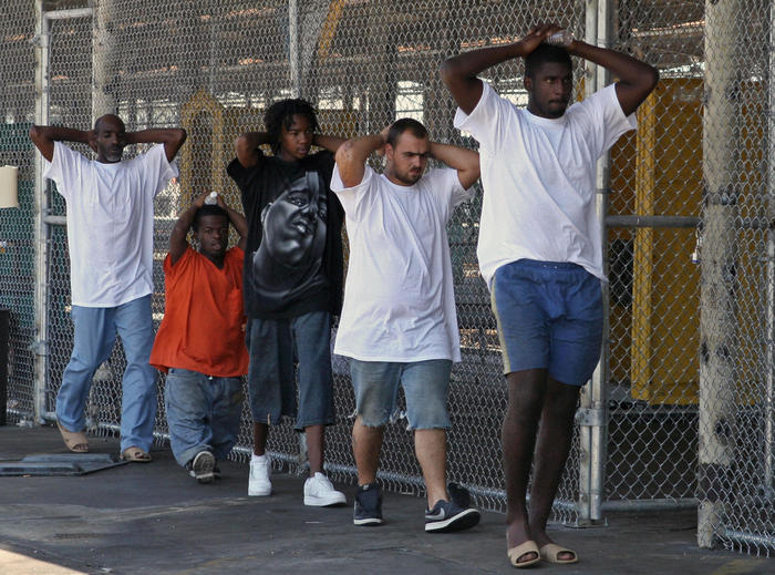 Inmates head back to their cells inside