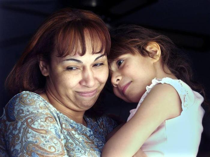 Luz Cuevas is reunited with her daughter in 2004.