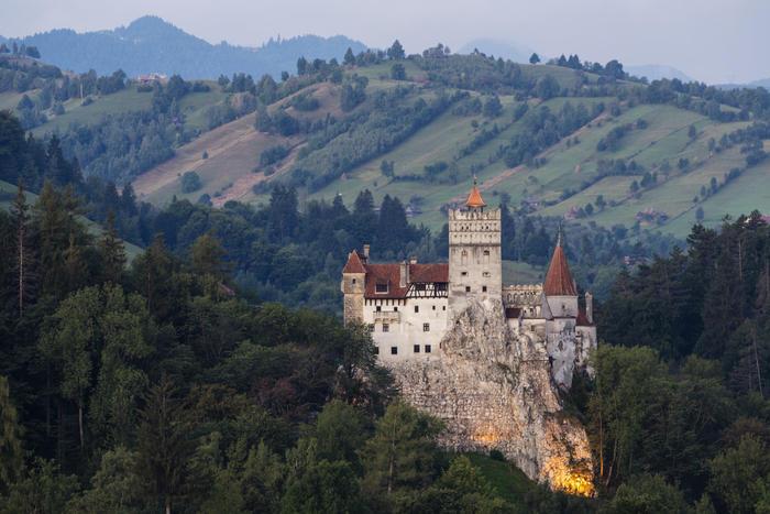 Bran Castle illuminated in rural landscape, Bran, Brasov, Romania