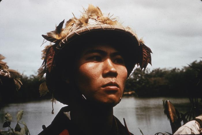 A close-up of a young soldier in camouflage gear, North Vietnam.