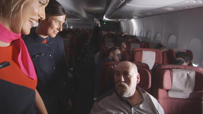 Qantas crew with passenger