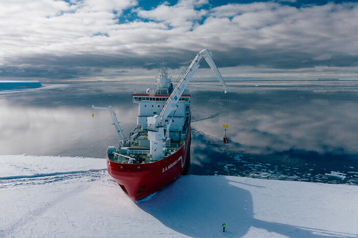 Aerial shot of the Agulhas II loading expedition members and kit from the Fimbul iceshelf before beginning its mission to find the Endurance