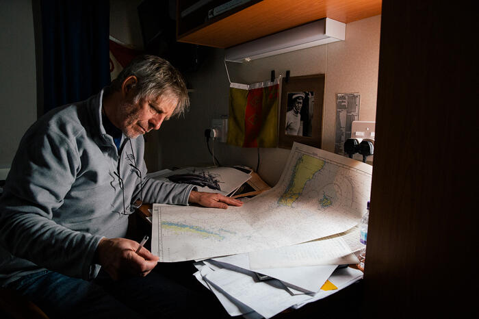 Archeologist Mensun Bound in his cabin looking at maps of the coordinates where the Endurance sank