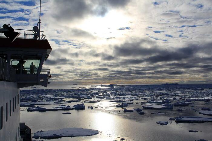 Captain Knowledge Bengu looks on from the bridge as Agulas II navigates a band of sea ice in the Weddell sea