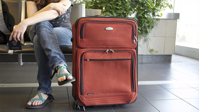 passenger with suitcase