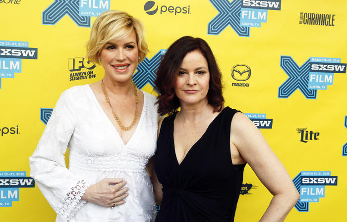 """Molly Ringwald, left, and Ally Sheedy walk the red carpet for """"The Breakfast Club"""" 30th Anniversary Restoration World Premiere during the South by Southwest Film Festival on Monday, March 16, 2015 in Austin, Texas. (Photo by Jack Plunkett/Invision/AP)"""