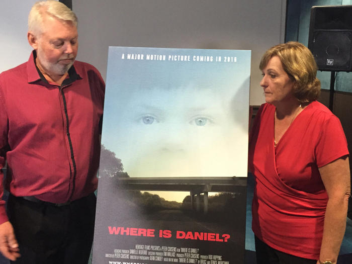 Bruce and Denise Morcombe pose with a promotional film poster.