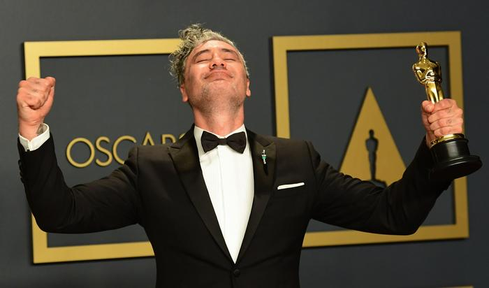 New Zealand director Taika Waititi poses in the press room with the Oscar for Best Adapted Screenplay for 'Jojo Rabbit'.