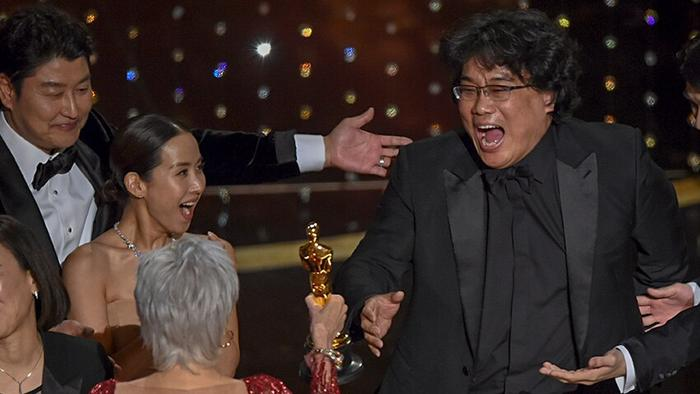 "Bong Joon Ho, right, reacts as he is presented with the award for best picture for ""Parasite"" from presenter Jane Fonda"