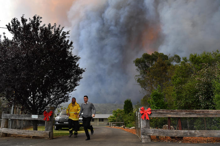 Rural Fire Service (RFS) crews engage in property protection of a number of homes along the Old Hume Highway near the town of Tahmoor.