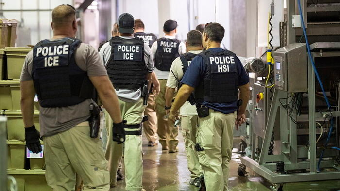 ICE officials and police during the raid in Mississippi.