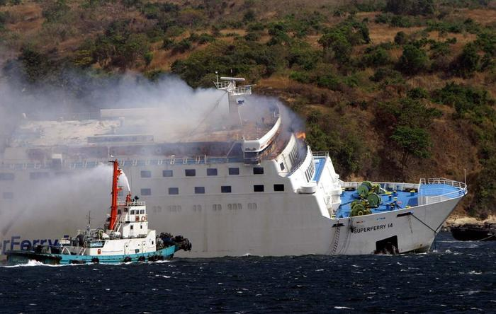 Smoke rises from the passenger ship WG&A Superferry 14 after an explosion (AAP)