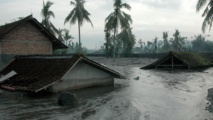 Abandoned homes near Indonesia's Yogyakarta are inundated by lahar coming from a large river caused by lava after the eruption of Mount Merapi in January 2011.