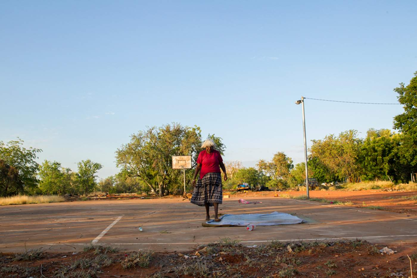The Hidden Valley Nitv Secret Lives Of Stoves In Remote Australian Indigenous Communities Bernadette Williams Prepares A Place To Sit And Yarn Shade On Basketball Court