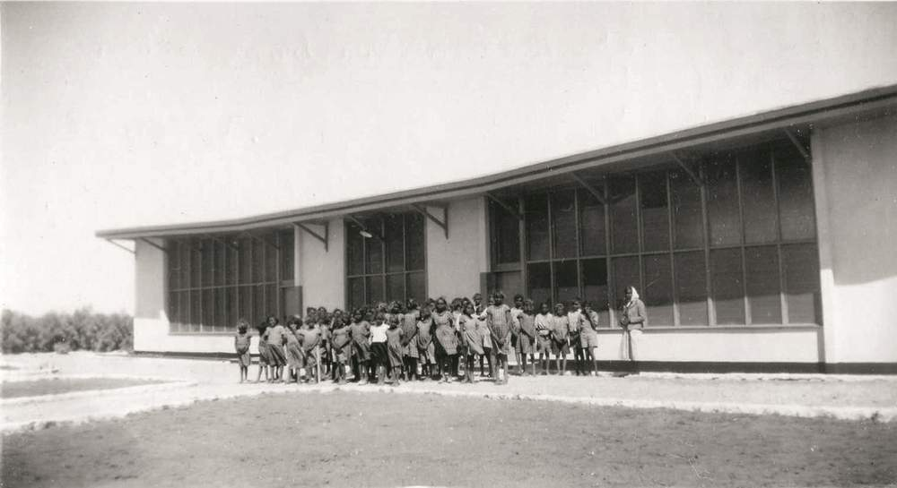 The children lined up at the front of the school, Hermannsburg, NT, 1953. (Image: Lutheran Archives)