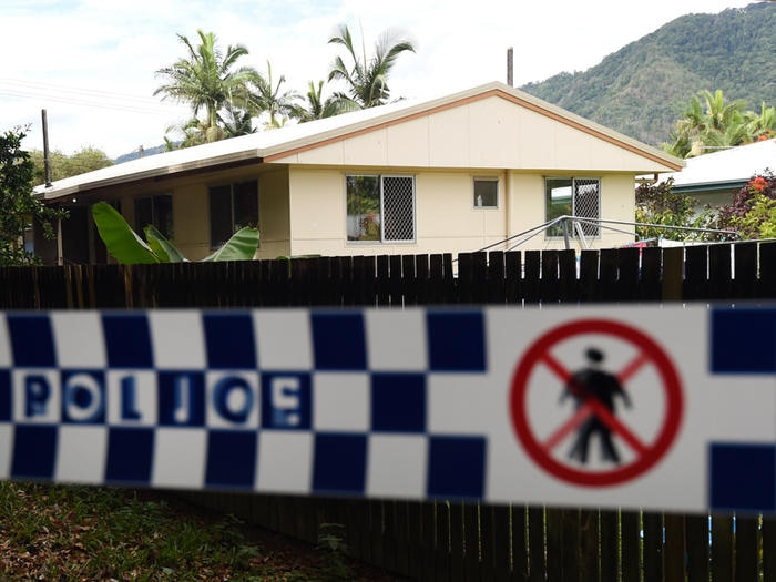 Police tape is seen around a house in which eight children were murdered in the Cairns suburb of Manoora, Saturday, Dec. 20, 2014. Their mother, who was taken hospital with stab wounds, has been arrested for murder. (AAP Image/Dan Peled) NO ARCHIVING