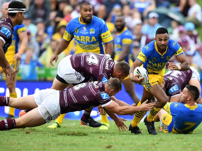 Bevan French of the Eels evades a tackle