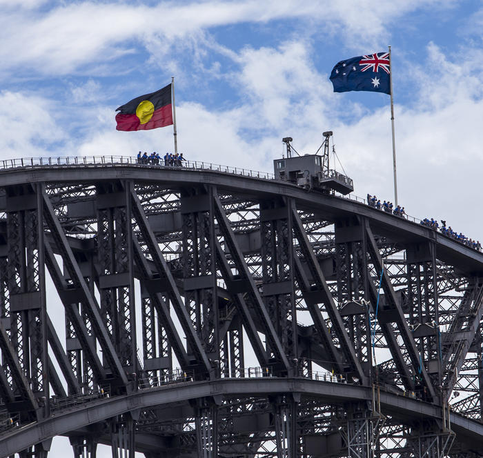 The Australian and the Aboriginal flags on top of the Sydney Harbour Bridge.