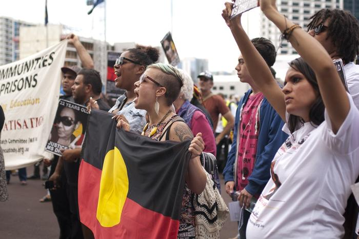 Protesters angry over Aboriginal deaths in custody gather outside WA Parliament House.