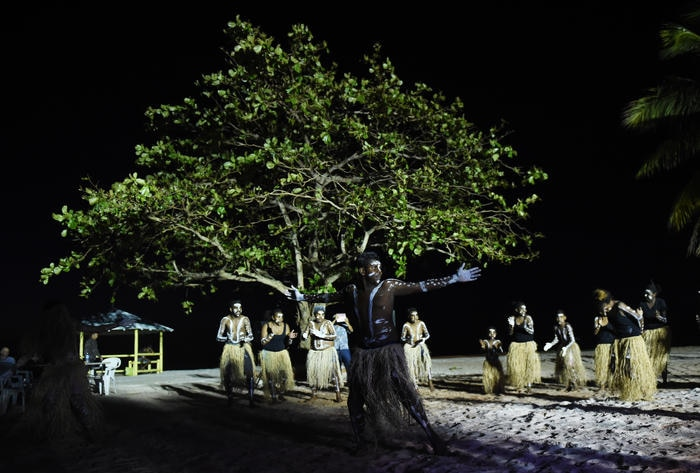 The Injinoo Dance Group perform a welcome to country for Australian Prime Minister Tony Abbott on the Injinoo Foreshore, Bamaga in the Northern Peninsula area, Tuesday, Aug. 25, 2015.