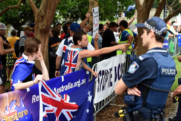 Protesters from the far right anti-Islam group Reclaim Australia rally in Brisbane, Sunday, Nov. 22, 2015. It is part of a national day of anti-Islam protests being held across the country. (AAP Image/Dan Peled) NO ARCHIVING