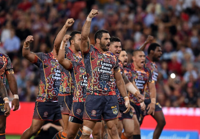 Greg Inglis, captain of the Indigenous All Stars (centre) and his teammates perform a war dance before their annual clash with the World All Stars at Suncorp Stadium in Brisbane.