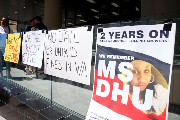 Signs put up by supporter of Ms Dhu outside the coroner's court in Perth on Friday, Dec. 16, 2016.