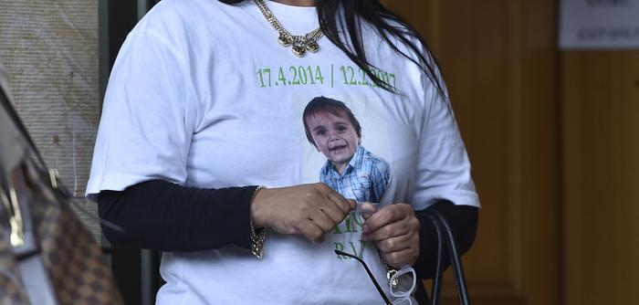 Supporters of the two-year-old Zayne Colson, who was killed in a hit and run, wear printed t-shirts with him on it outside the court.