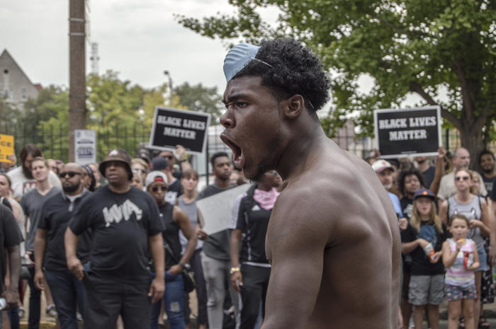 Protesters gather at a peaceful rally in front of St. Louis Metropolitan Police Headquarters in St. Louis