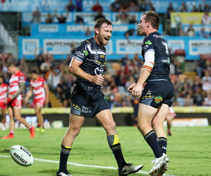 Gavin Cooper of the Cowboys congratulates Michael Morgan of the Cowboys on his try during the Round 1 NRL match. (AAP Image/Michael Chambers)