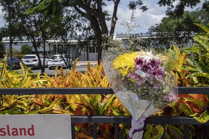 A floral tribute left at Hambledon State School  to remember the three year old boy who died  when  left in a day care minibus at Edmonton.