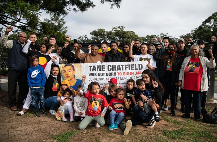 Supporters of Tane Chatfields parents Colin and Nioka Chatfield pose with them for a photograph outside the inquest into Tane Chatfields death.