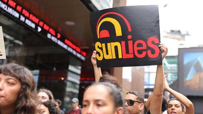 """Protesters rally outside Channel 7 studios Sydney to protest against Channel 7 breakfast show """"Sunrise"""" Aboriginal adoption segment."""