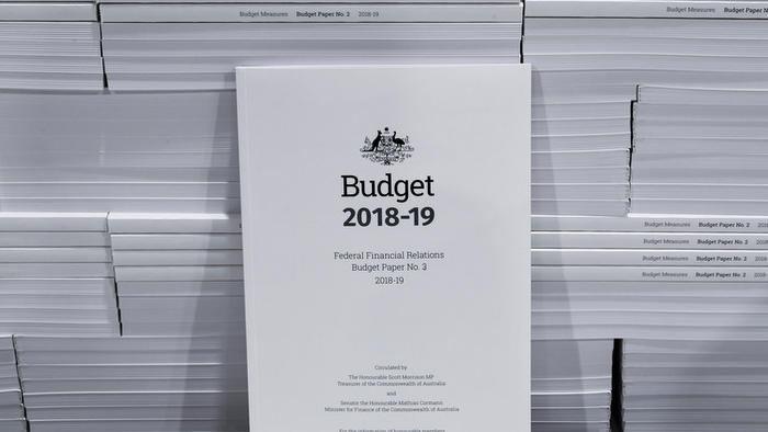 The cover of the 2018-19 Budget papers is seen at Canprint in Canberra, Sunday, May 6, 2018. Australia's Treasurer Scott Morrison will deliver his third Budget on Tuesday, May 8. (AAP Image/Lukas Coch) NO ARCHIVING