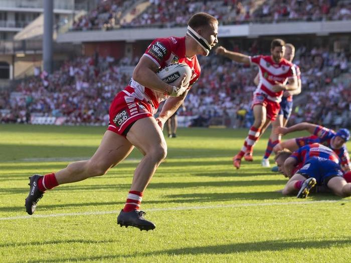 Euan Aitken of the Dragons scores during the Round 4 NRL match.