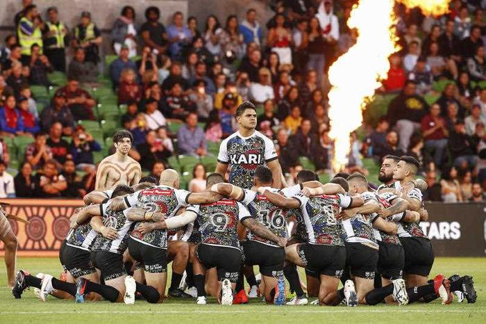 Indigenous players perform a traditional war cry during the NRL Indigenous All-Stars vs Maori All Stars match at AAMI Park, Melbourne, Friday, February 15, 2019.