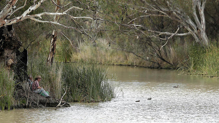 Two locals fish in the Murray river in Wentworth, 1,043 kilometers from Sydney (AP)