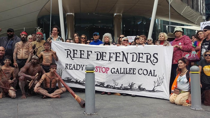 File image of anti-mining protesters outside mining giant Adani's offices during a rally in Brisbane,  2015.