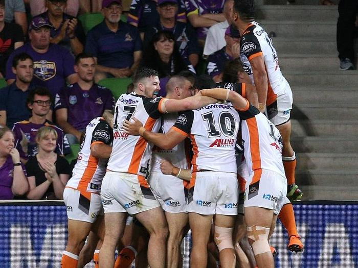 The Tigers celebrate a late try.