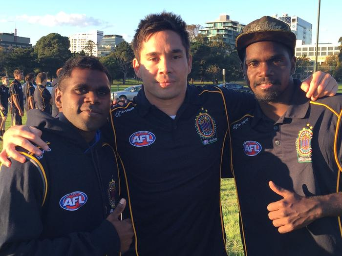 Former AFL player Matthew Stokes (middle) amongst participants