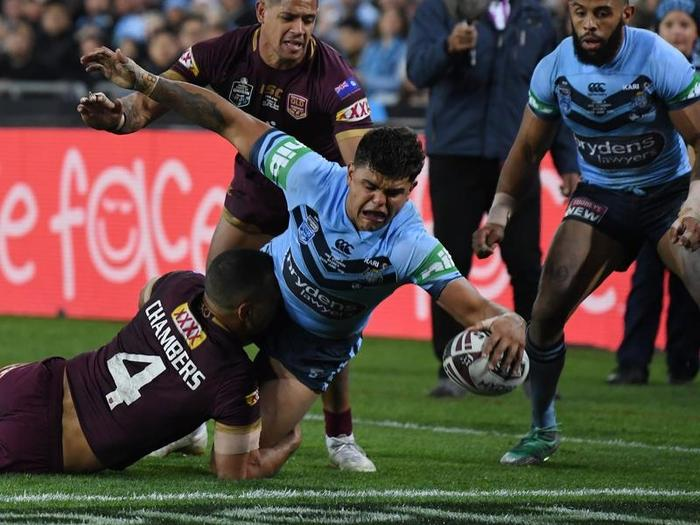 Latrell Mitchell of the Blues scores a try.