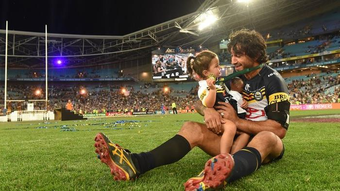 Cowboys captain Johnathan Thurston with his daughter.